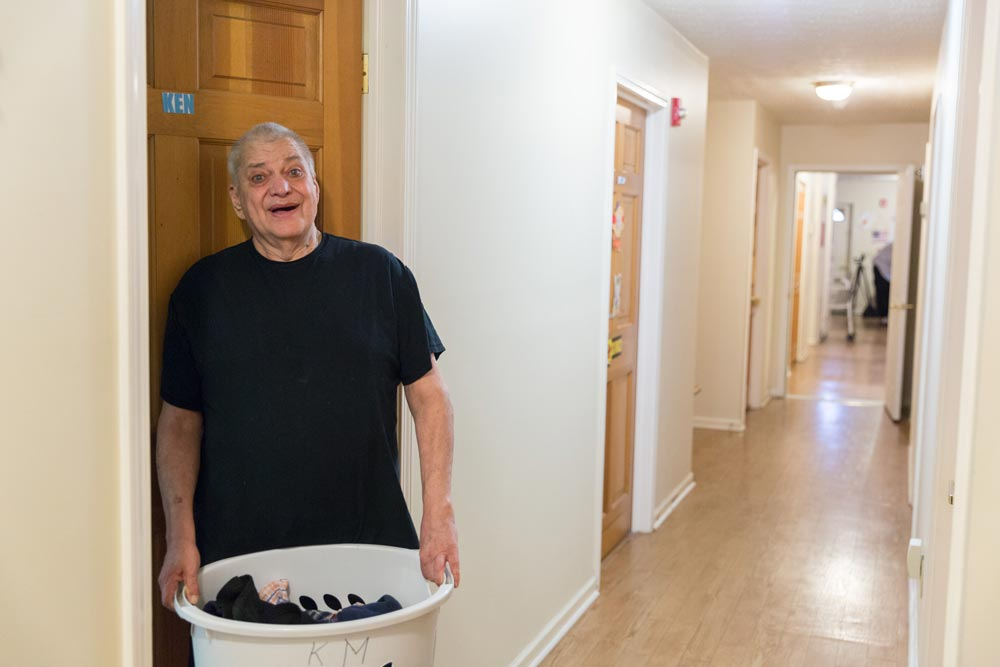man carrying laundry